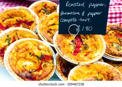 Delicious round blueberry Delicious round roasted pepper and parmesan tarts in British market
