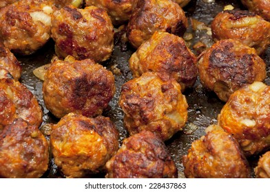 Delicious rustic famous roasted meat balls with carrot and onion on the tray just from oven