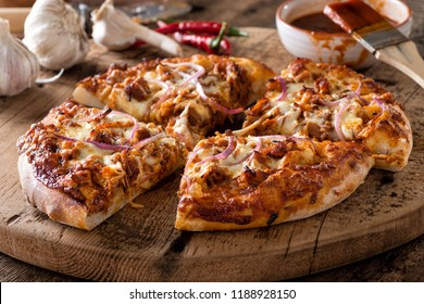 A delicious rustic homemade pizza with bbq pulled pork and red onion.