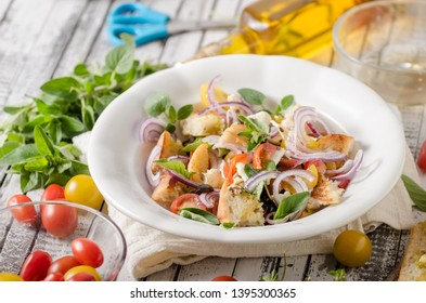 Delicious salad with fresh vegetable, crispy croutons and cheese
