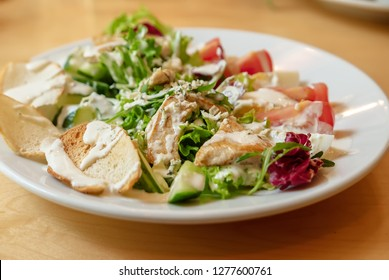 Delicious salad with grilled chiken and fresh vegetables, food background