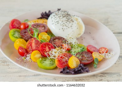 delicious salad of mix of colorful tomatoes and mozzarella with chia seeds, tasty and healthy
