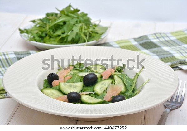 Delicious salad with salmon, olives and cucumber