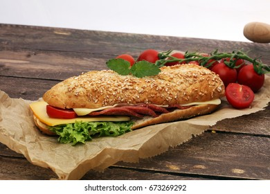 Delicious salami cheese and ham baguettes with fresh lettuce
