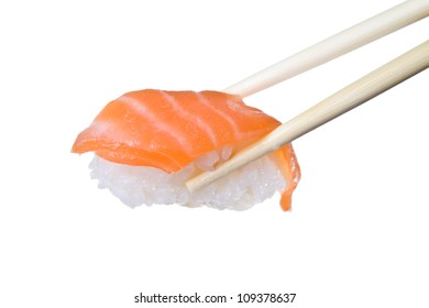 Delicious salmon sushi holding by chopsticks on white background