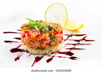 Delicious Salmon tartare with vegetables on white background