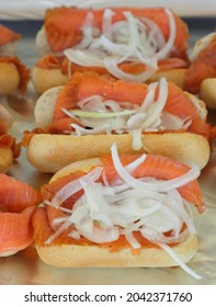 Delicious sandwich with fresh salmon and onion