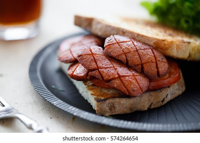 Delicious sandwich made with grilled sausage (Turkish sucuk)