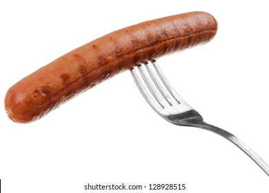 a delicious sausage on a fork over white