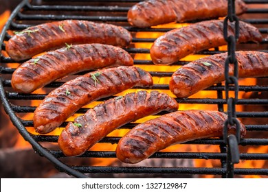 Delicious sausage on grill with herbs and spices