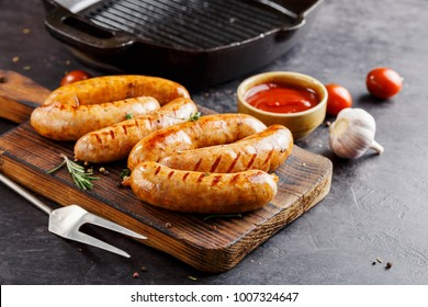 Delicious sausages grilled with spicy sauce. Selective focus