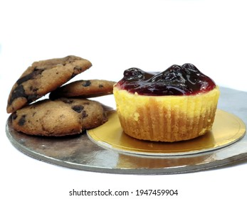 Delicious and scrumptious Chocolate chip cookies and cheesecake, on white studio background.