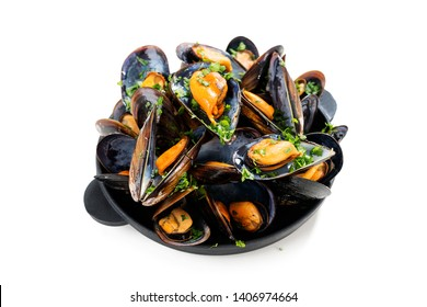 Delicious seafood mussels with  parsley sauce and lemon. isolated on white background