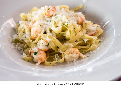 The delicious seafood restaurant dish from Croatia food (croatian cuisine) - fresh seafood pasta with tagliatelle, adriatic shrimps and parmesan cheese