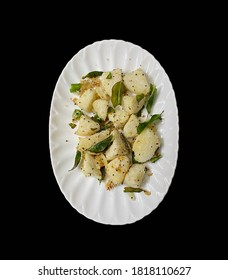 Delicious Seasoned or Fry Idly or idli served in a plate