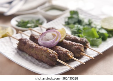 Delicious seekh kabab served in plate at table