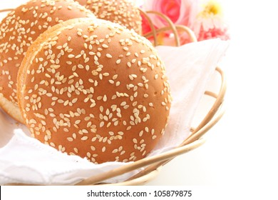 Delicious Sesame Hamburger bun on basket with copy space