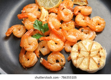 Delicious shrimps with garlic in frying pan, closeup