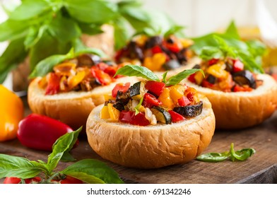 "Delicious Sicilian vegetable dish ""Eggplant Caponata"" served in bread bowls. Healthy vegetarian food."
