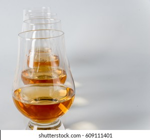 delicious single malt whiskey glass with another glasses on a white background, whisky single malt