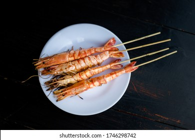 Delicious skewers with grilled prawns, shrimps. Traditional vietnamese cuisine served in harbour restaurant on Phu Quoc, Vietnam.