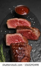 Delicious sliced beef tenderloin on table, closeup