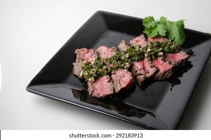 Delicious sliced steak with chimichurri sauce