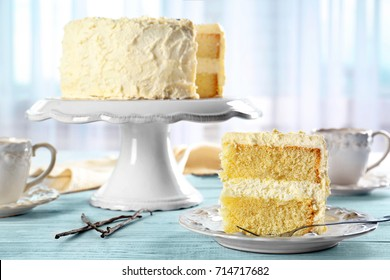 Delicious sliced vanilla cake on wooden table