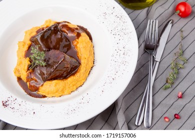 Delicious slow-cooked veal with pumpkin puree and brown sauce.