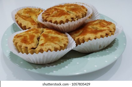 Delicious small apple pie on green plate