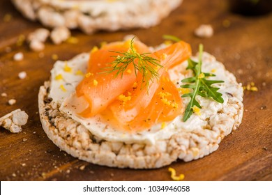Delicious smoked salmon and cream cheese on rice bread toasts.