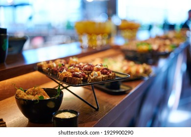 Delicious snacks from freshly baked bread, sauce and meat at the bar in the restaurant