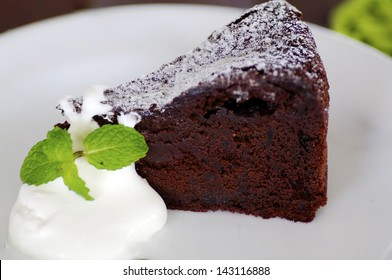 Delicious soft Chocolate Cake. Shallow Depth of Field with Focus on the surface ot the cake.