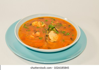 delicious soup with mussels on white background