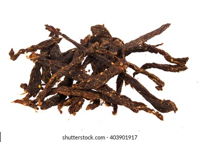 Delicious South African Biltong beef sticks, flavoured with chili pepper, also known as chili bites on a white background.