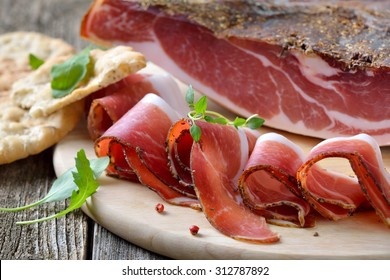 Delicious South Tyrolean bacon, a regional specialty, prepared according to traditional  recipes, often served with the Tyrolean crispy flat bread