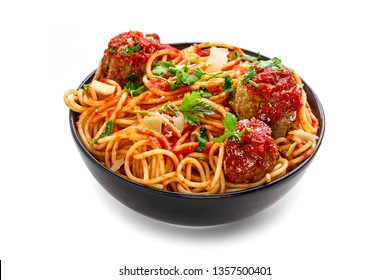 Delicious spaghetti pasta with meatballs and tomato sauce in a bowl. Traditional American Italian food isolated on white background.
