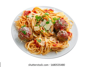 Delicious spaghetti pasta with meatballs and tomato sauce on a white plate. Traditional American Italian food isolated on white background.