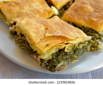 """delicious """"spanakopita"""" traditional Greek spinach and feta pie portions close up"""