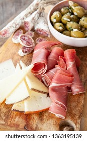 Delicious Spanish tapas with cured meat, cheese and olives