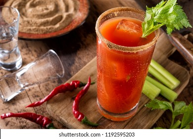 A delicious spicy bloody caesar cocktail with vodka, tomato juice, clam juice, hot sauce and celery.