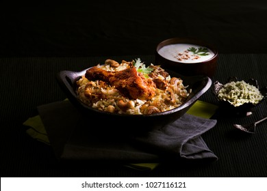Delicious and spicy chicken biryani in traditional pot