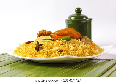 Delicious spicy chicken biryani in white bowl on white background, Indian or Pakistani ramzan food. Beautiful view of traditional spicy indian food, Iftar meal, Ramadan dinner.