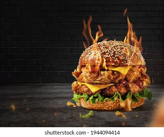 Delicious spicy fried chicken burger ads with burning fire on dark background