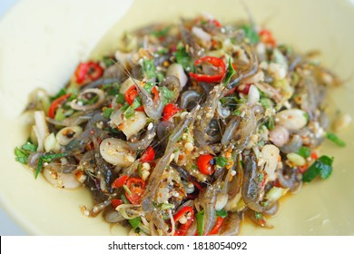 Delicious and spicy traditional raw Thai shrimp salad  with herbs as ingredients on plate.Weird food and street food concept in Thailand. Very popular in the northern and eastern Thai Selective focus