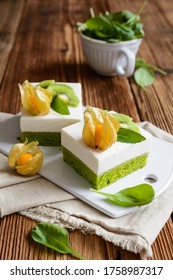 Delicious spinach sponge cake topped with curd mixed with whipped cream, decorated with golden berries and kiwi slices
