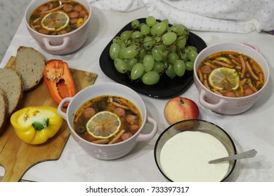 a delicious still life with a hodgepodge, green grapes, sour cream and lemon. Russian national cuisine. Ukrainian national food. Nutritious healthy food without chemicals