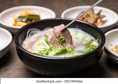 Delicious stock soup of bone and stew meat in a hot pot