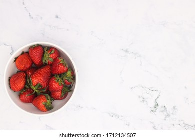 Delicious strawberries in bowl on the table