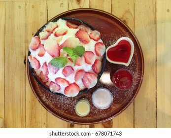 Delicious strawberry bingsu or bingsoo, Korean dessert, Bingsoo or Bingsu,Korean shaved ice dessert with sweet toppings.